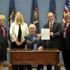 Livingston County officials join Rep. Vaupel and Governor Snyder for bill-signing ceremony